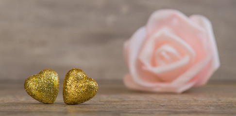 Valentines Day background with two golden hearts