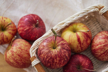 High angle view of apples with basket on table
