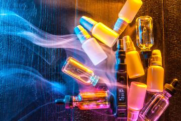 A concept with an electronic cigarette. Vape. Bottles with liquid for electronic cigarette.  A concept Vape.