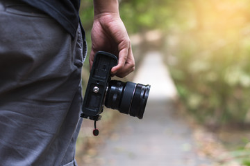 male photographer, hand hold camera, outdoor