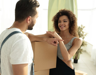 Married couple moving to a new apartment