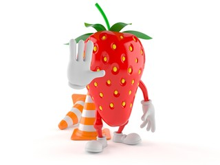 Strawberry character with traffic cone