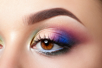 Closeup view of woman eye with evening makeup