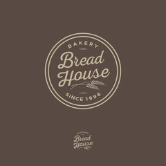 Bakery logo. Bread Shop emblem. Lettering and spikelet in a circular badge.
