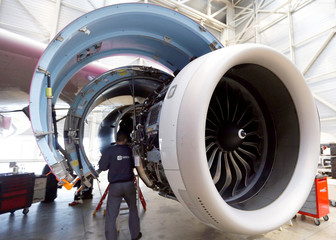 An employee does maintenance tasks on an Airbus A320 engine in the recycling and storage yard at the base of French aerospace company Tarmac Aerosave in Azereix near Tarbes