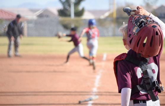 Baseball catcher watching down the line