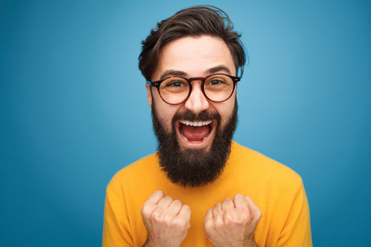 Excited bearded man in glasses
