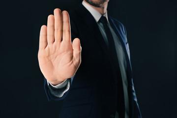 Businessman refusing to take bribe on black background