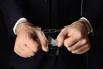 Businessman in handcuffs, closeup