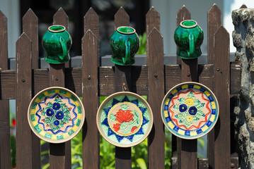 Hand-made crockery dryed on fence