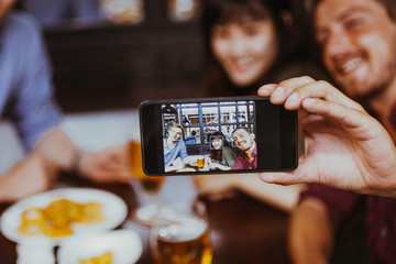 Three Friends Taking Selfie Photo in Pub