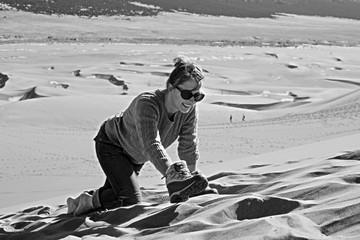 Young Woman Climbing a Sand Dune in Colorado