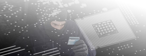 Composite image of focused burglar using computer and debit card