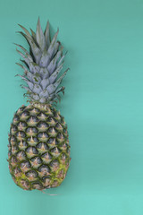 Top view of colorful fruit pattern of fresh pineapple on green background