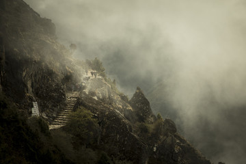 Stone staircase on mountainside with clouds and fog at Everest Base Camp Trek, Pangboche, Khumbu, Nepal