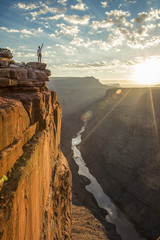 Hiker standing at edge of cliff of Toroweap Overlook in North Rim of Grand Canyon, Arizona, USA
