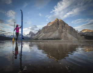 Rear view of person walking on Bow Lake, Banff, Alberta, Canada
