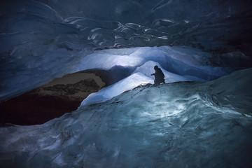 Man exploring Athabasca Glacier at night, Jasper National Park, Alberta, Canada