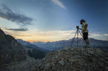 Photographer with tripod in mountains, Survey Peak, Banff National Park, Alberta, Canada