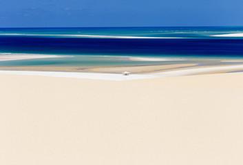 Beach tent in middle of sandy coastal beach
