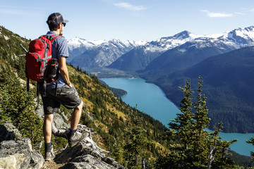 Male hiker admiring scenic landscape of Cheakamus Lake, Whistler, British Columbia, Canada