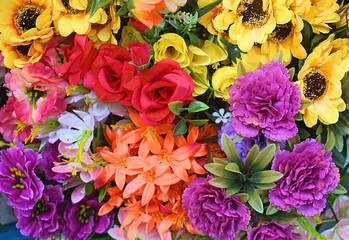 Close up fresh flower bouquet sale for valentine day at fresh market. Variety of colorful flower background. Selective focus on group of flower sell at the market