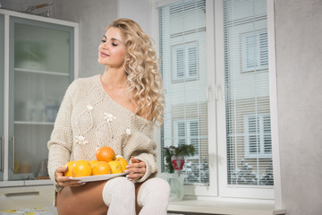 Blonde woman in living room interior