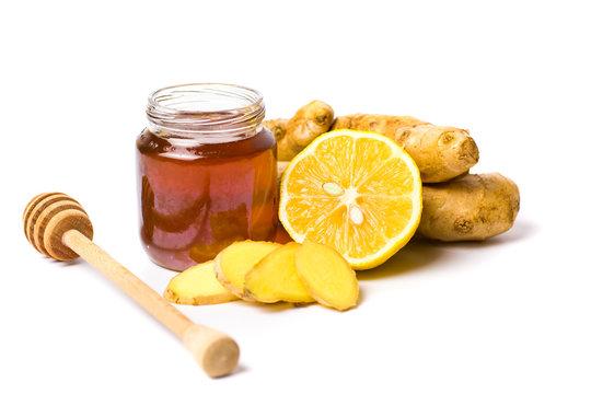 Jar of honey and lemon gingers isolated on white