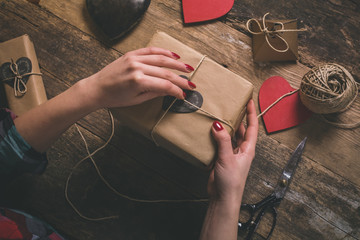 Unrecognizable woman packing Valentine's Day gift