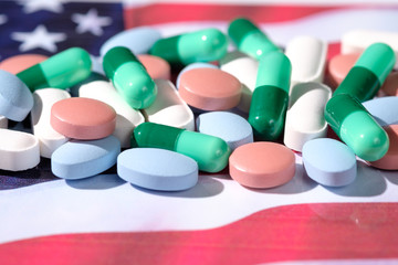 Various pills on American flag background