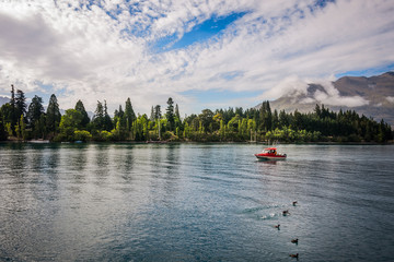 A fishing boat in the morning at  Queenstown bay on the shore of Lake Wakatipu, Otago Region, New Zealand, Southern Island.