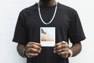 African man holding a picture