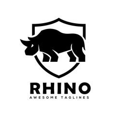 Rhino with shield logo vector, Rhinoceros shield logo monochrome color Business template, Rhinos logo for sport club or team. Animal mascot logotype , Vector illustration.