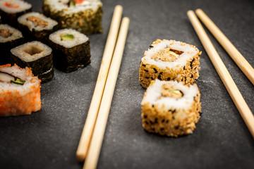 Sushi rolls hosomaki and uramaki
