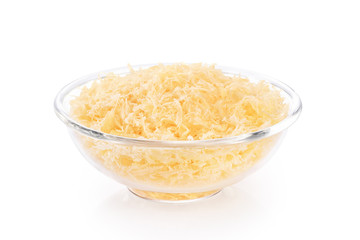 Grated parmesan cheese in a glass bowl isolated on white background.