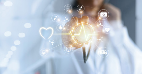 Medicine doctor with  stethoscope in hand touching icon medical network connection with modern virtual screen interface, medical technology network concept