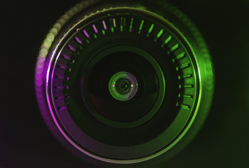 Camera lens with green pink color