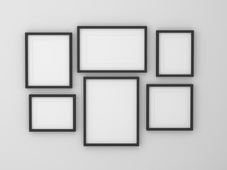 group of blank empty picture frame on the wall