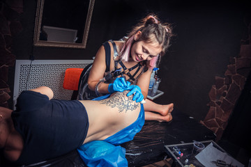 Master doing tattoo picture in tattoo parlor