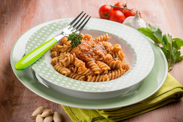fusilli with almond and tomatoes pesto sauce, selective focus
