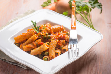 pasta with vegetables ragout and peas, selective focus