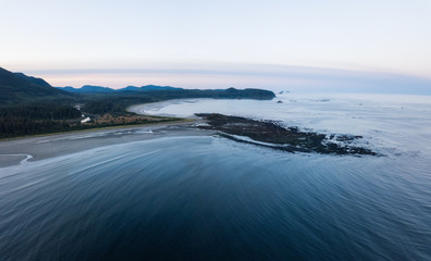Aerial Panoramic Landscape View of Pacific Ocean Coast in Washington State. Taken during a vibrant sunrise.
