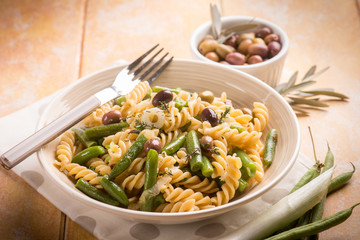 pasta with green beans and black olives, selective focus