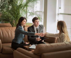 handshake of the manager and the client after the contract discussion in the lobby of the modern office