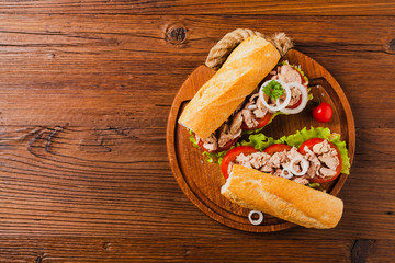Delicious tuna sandwich, served with lettuce, tomato and onion.