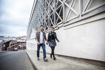 couple in love walking down the street of a modern city.