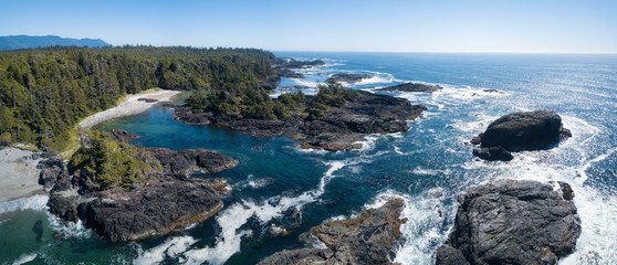 Aerial panoramic seascape view of the Rocky Pacific Coast during a vibrant sunny summer day. Taken near Tofino, Vancouver Island, British Columbia, Canada.
