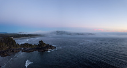 Aerial panoramic view of the beautiful Pacific Ocean Coast during a vibrant summer sunset. Taken near Tofino, Vancouver Island, British Columbia, Canada.