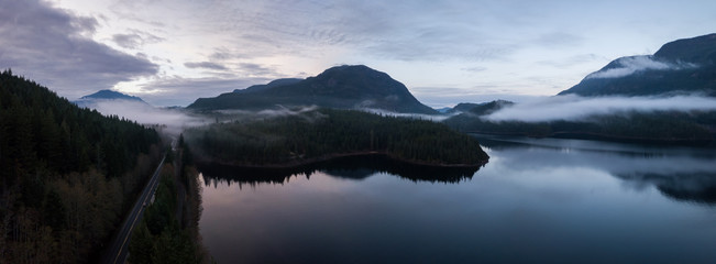 Aerial Drone Panoramic View of the Beautiful Canadian Landscape during a cloudy sunset. Taken in Vancouver Island, British Columbia, Canada.