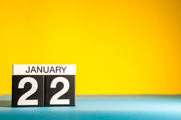 January 22nd. Day 22 of january month, calendar on yellow background. Winter time. Empty space for text